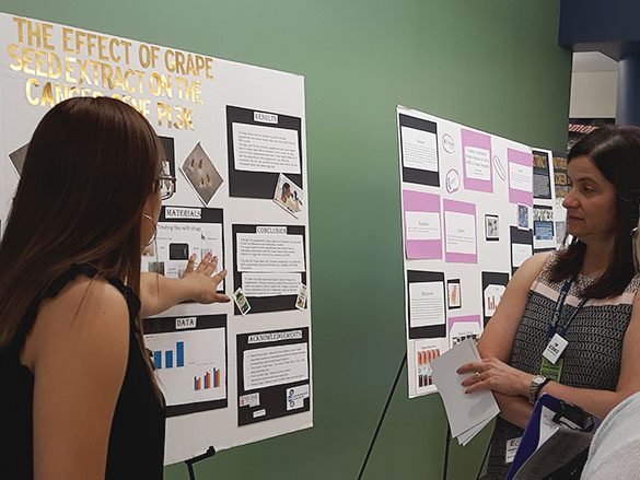 Student Presenting to Scientist